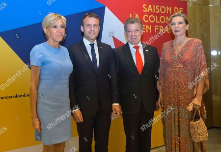 Stock Image of From left to right, Brigitte Macron, the wife of France's President Emmanuel Macron, Colombia's President Juan Manuel Santos and his wife Maria Clemencia Rodriguez pose prior to a concert at the Philharmonie de Paris concert hall in Paris, France, . Colombian President Juan Manuel Santos is on a three-day visit to France