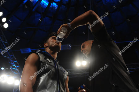 Josh Kelly takes a drink from Adam Booth during a Boxing Show at the Walker Activity Dome on 23rd June 2017
