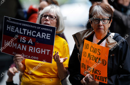 Jo Ann Waker Farrand, Jan Miller Jo Ann Waker-Ferrand, left, and Jan Miller, both of Denver, wave their placards during a protest, in downtown Denver, against the Republican health bill that was recently unveiled in the U.S. Senate. More than 100 protesters crowded the sidewalk outside the building in which U.S. Senator Cory Gardner, R-Colo., has his office