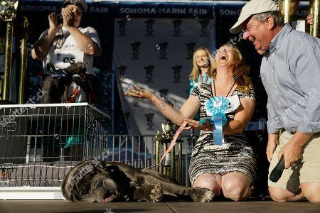 Shirley Zindler, of Sebastopol, Calif., reacts after Martha, a Neapolitan Mastiff, won the World's Ugliest Dog Contest at the Sonoma-Marin Fair, in Petaluma, Calif. At right is judge Kerry Sanders