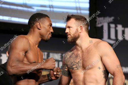 Ryan Bader, Phil Davis Light Heavyweight champion Phil Davis (L) is seen facing off against Ryan Bader during a weigh-in before Bellator 180, in New York