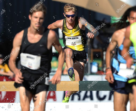 Aric Van Halen jumps into the water during a heat of the first round of the men's 3,000-meter steeplechase at the U.S. Track and Field Championships, in Sacramento, Calif. Van Halen is the son of rock-n-roll drummer Alex Van Halen