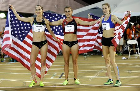 Shannon Rowbury, Shelby Houlihan, Molly Huddle Shannon Rowbury, Shelby Houlihan, and Molly Huddle, from left, hold U.S. flags after running the women's 5,000 meters at the U.S. Track and Field Championships, in Sacramento, Calif. Houlihan won the race, Rowbury finished second, and Huddle third