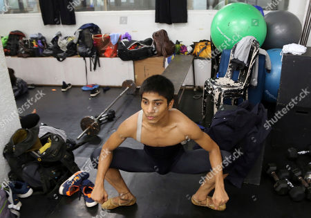 15-year-old ballet dancer Amiruddin Shah stretches at a dance academy in Mumbai, India. The teenage son of a welder from a Mumbai slum has won a spot at the prestigious American Ballet Theatre's Jacqueline Kennedy Onassis School in New York. Shah was doing backflips and contemporary dance when his American Israeli instructor first discovered his talent. Now, he's trying to raise funds to cover his training in the US