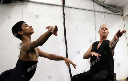 15-year-old ballet dancer Amiruddin Shah, left, practices with Israeli-American instructor Yehuda Maor in Mumbai, India. The teenage son of a welder from a Mumbai slum has won a spot at the prestigious American Ballet Theatre's Jacqueline Kennedy Onassis School in New York. Shah was doing backflips and contemporary dance when Maor first discovered his talent. Now, he's trying to raise funds to cover his training in the US