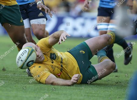 Australia's Stephen Moore dives for the ball during the International rugby match between Australia and Italy in Brisbane, Australia, Saturday, 24 June, 2017