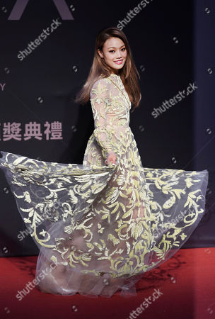 Hong Kong singer Joey Yung smiles as she arrives at the 28th Golden Melody Awards in Taipei, Taiwan, . Yung is a guest at this year's Golden Melody Awards, one of the world's biggest Chinese-language pop music annual events