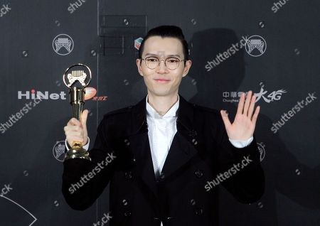 Stock Picture of Hong Kong singer Khalil Fong holds his award for the Best Male Mandarin Singer at the 28th Golden Melody Awards in Taipei, Taiwan, . The Golden Melody Awards are one of the Chinese-language pop music world's biggest annual events