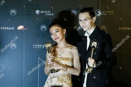 Stock Photo of Eve Ai, Khalil Fong Taiwanese singer Eve Ai and Hong Kong singer Khalil Fong hold their awards for the Best Female and Male Mandarin Singer at the 28th Golden Melody Awards in Taipei, Taiwan, . The Golden Melody Awards are one of the Chinese-language pop music world's biggest annual events