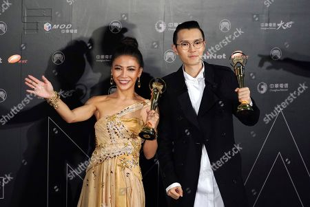 Stock Image of Eve Ai, Khalil Fong Taiwanese singer Eve Ai and Hong Kong singer Khalil Fong hold their awards for the Best Female and Male Mandarin Singer at the 28th Golden Melody Awards in Taipei, Taiwan, . The Golden Melody Awards are one of the Chinese-language pop music world's biggest annual events