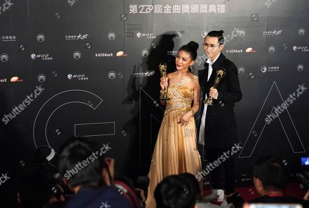 Eve Ai, Khalil Fong Taiwanese singer Eve Ai and Hong Kong singer Khalil Fong hold their awards for the Best Female and Male Mandarin Singer at the 28th Golden Melody Awards in Taipei, Taiwan, . The Golden Melody Awards are one of the Chinese-language pop music world's biggest annual events