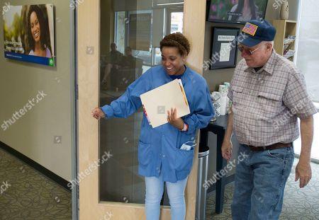 Megan Jones, Robert Hall Dental assistant Megan Jones, left, greets patient Robert Hall during Aspen Dental's Day of Service, in New Braunfels, Texas
