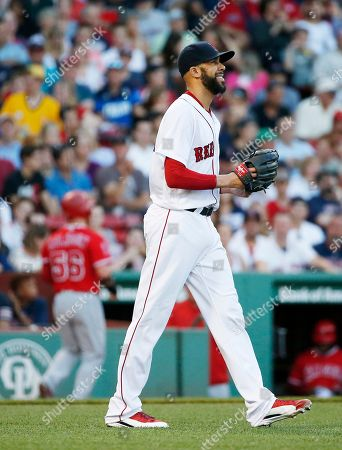 David Price, Kole Calhoun Boston Red Sox's David Price, right, walks back to the mound after Los Angeles Angels' Kole Calhoun, rear, scored on a single by Martin Maldonado during the first inning of a baseball game, in Boston