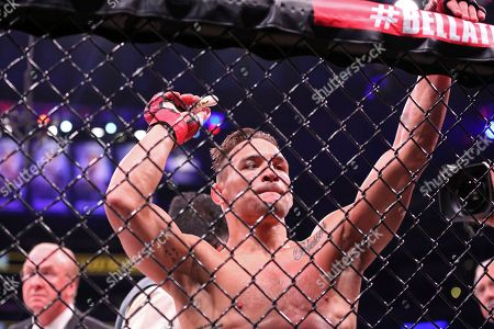 Michael Chandler looks dejected after the doctor stopped his fight against Brent Primus in a mixed martial arts bout for the lightweight title at Bellator 180, in New York. Primus won the title via first round doctor stoppage
