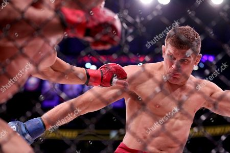Michael Chandler, Brent Primus Brent Primus, right, lands a kick against Michael Chandler in a mixed martial arts bout for the lightweight title at Bellator 180, in New York. Primus won the title via first round doctor stoppage