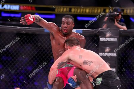 Ryan Bader, Phil Davis Ryan Bader scores a takedown against Phil Davis in a mixed martial arts bout for the light heavyweight title at Bellator 180, in New York. Bader won via decision to win the title