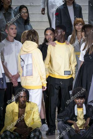 Bastien Laurent with models on the catwalk