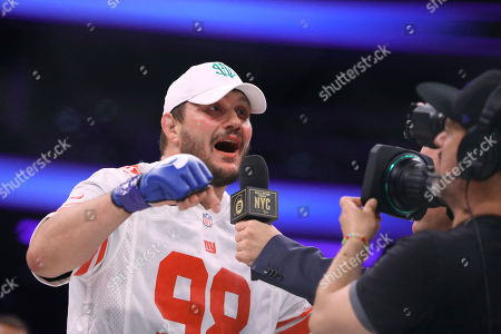 Matt Mitrione is interviewed in a New York Giants jersey after a win against Fedor Emelianenko in a mixed martial arts bout at Bellator 180, in New York. Mitrione won via first-round stoppage