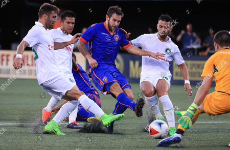 Miami FC midfielder Dylan Mares (7) drives the ball into the goal zone defended by New York Cosmos defender Jimmy Mulligan (28), left, New York Cosmos midfielder Andrifes Alexander Flores Mejia (11), left center, New York Cosmos midfielder Juan Guerra (16), right center, and New York Cosmos goalkeeper Jimmy Maurer (1), right, during a North American Soccer League game between the New York Cosmos vs Miami FC at the Riccardo Silva Stadium in Miami, Florida. Miami FC won 2-1
