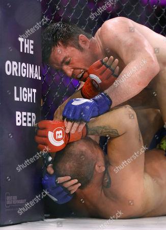 Chael Sonnen, Wanderlei Silva Chael Sonnen, top, lands blows against Wanderlei Silva, of Brazil, during a mixed martial arts bout at Bellator 180 early, in New York. Sonnen won via unanimous decision