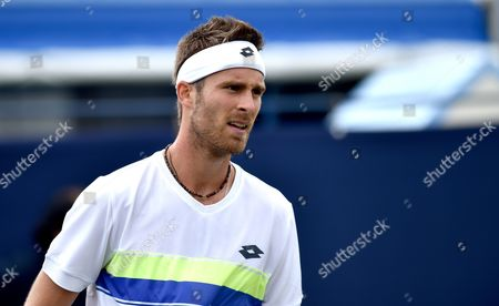 Luke Bambridge of Great Britain in action against Norbert Gombos of Slovakia during the Aegon International Eastbourne tennis tournament at Devonshire Park in Eastbourne East Sussex UK. 25 Jun 2017