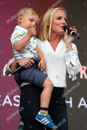 Kerry Ellis with her son giving a thumb's up at West End Live theatre showcase, Trafalgar Square, London,