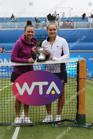 Casey Dellacqua and Ashleigh Barty of Australia after winning the doubles final during the Aegon Classic Birmingham Final at Edgbaston Priory Club
