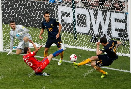 Australia's Ryan James Mcgowan, right, clears a ball in front of Australia's Dylan John Mcgowan, left, during the Confederations Cup, Group B soccer match between Chile and Australia, at the Spartak Stadium in Moscow