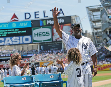 Former New York Yankees Tim Raines waves to fans during Old-Timers' Day at Yankee Stadium, in New York