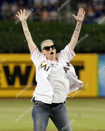 Actress Lori Petty reacts after throwing a ceremonial pitch before a baseball game between the Miami Marlins and Chicago Cubs, in Miami. Petty was in the 1992 film A League of Their Own