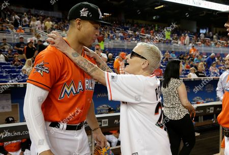 Lori Petty, Giancarlo Stanton Actress Lori Petty, right, talks with Miami Marlins right fielder Giancarlo Stanton before throwing a ceremonial pitch before a baseball game between the Miami Marlins and Chicago Cubs, in Miami. Petty was in the 1992 film A League of Their Own