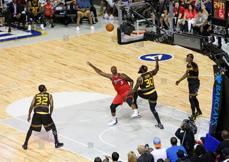 Eddie Robinson, Al Harrington, Reggie Evans. Steven Jackson Trilogy player/co-captain Al Harrington (3) watches his shot as Killer 3's Reggie Evans (30) defends during the first half of Game 4 in the BIG3 Basketball League's debut, at the Barclays Center in New York. Killer 3's Eddie Robinson (32) and player/co-captain Stephen Jackson also watch from the floor