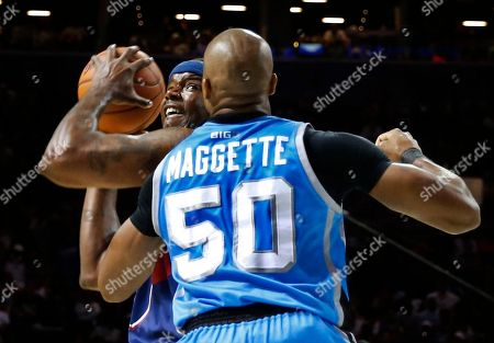 Stock Photo of Jermaine O'Neal, Corey Maggette Tri State player-captain Jermaine O'Neal, left, looks to shoot with Power player/captain Corey Maggette (50) defending during the first half of Game 2 in the BIG3 Basketball League debut, at the Barclays Center in New York