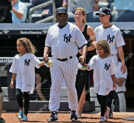 Former New York Yankees Tim Raines and his family participate in Old-Timers' Day at Yankee Stadium, in New York