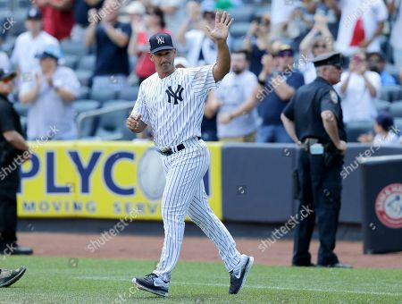 Former New York Yankee Jorge Posada waves during Old-Timers' Day at Yankee Stadium, in New York