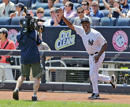Former New York Yankee Willie Randolph waves during Old-Timers' Day at Yankee Stadium, in New York