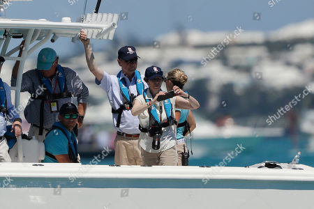 Stock Picture of England's Princess Anne records with a phone as her husband Timothy Laurence, third from right, looks on after the eighth race of America's Cup sailing competition between Oracle Team USA and Emirates Team New Zealand, in Hamilton, Bermuda