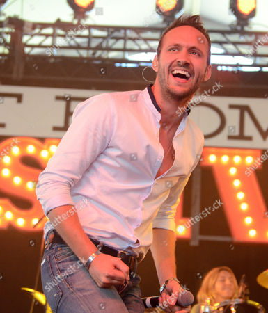 Stock Photo of Drew Baldridge performs during the Country LakeShake music festival in Chicago, Illinois