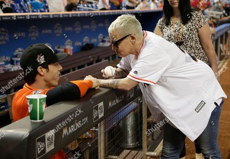 Stock Photo of Lori Petty, Christian Yelich Miami Marlins' Christian Yelich, left, talks with actress Lori Petty who threw a ceremonial pitch before a baseball game between the Miami Marlins and Chicago Cubs, in Miami. Petty was in the 1992 film A League of Their Own