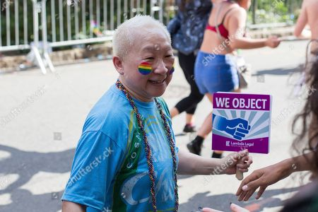 Lori Tan Chinn greets fans in the crowd during the New York City Pride Parade, in New York