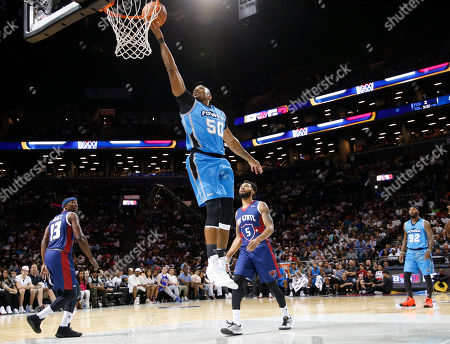 Stock Image of Corey Maggette, Xavier Silas Power player/captain Corey Maggette shoots as Tri-State' Mike James and Xavier Silas (5) look on during the first half of the Game 2 in the BIG3 Basketball League's debut, at the Barclays Center in New York