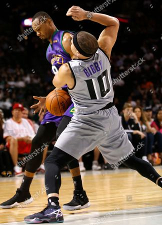 Rashard Lewis, Mike Bibby 3 Headed Monsters' player/captain Rashard Lewis, left, loses the ball as he collides with Ghost's player/captain Mike Bibby (10) during the first half of the BIG3 Basketball League debut, at the Barclays Center in New York