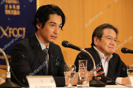 "Stock Picture of Japanese actor Dean Fujioka (L) and film director Shinichi Nishitani speak at a press conference for their latest movie ""Marriage"" (Kekkon) after a sneak preview screening"