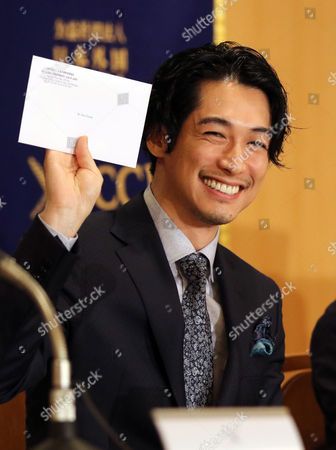 "Stock Image of Japanese actor Dean Fujioka smiles as he receives one-year membership of the press club at a press conference for his latest movie ""Marriage"" (Kekkon) after a sneak preview screening"