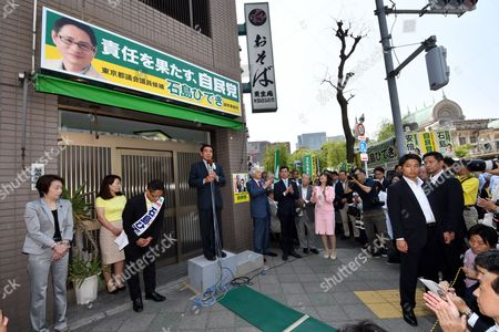 Stock Photo of Hakubun Shimomura, chairman of the Federation of Tokyo Metropolitan Liberal Democratic Party Branches, speaks at a kick-off rally of an LDP candidate as official campaigning started for the Tokyo Metropolitan Assembly election