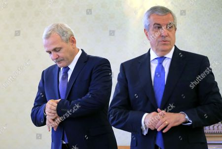 Liviu Dragnea (L), the President of the Romanian Parliament's Deputee Chamber, also the leader of the main ruling party PSD (Social Democracy Party) checks his watch as Calin Popescu Tariceanu (R), the head of Senate Chamber, looks aside while they are waiting for the Romania's President Klaus Iohannis (not pictured), during the consultations held at Cotroceni Palace in order to establish the future Prime Minister, in Bucharest, Romania on 26 April 2017. Mihai Tudose, 50, former economy minister under Grindeanu cabinet, was proposed by the main ruling party PSD (Social Democracy Party) as their nomination for premier. Tudose must be designated as the new prime minister by the Romanian President and his cabinet must pass the parliament vote. The government directed by Sorin Grindeanu was ousted after a no-confidence vote was pushed by PSD in parliament last week. Dragnea and Tariceanu are the leaders of the ruling coalition that have the majority in parliament.