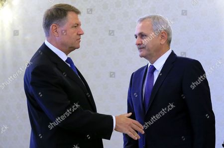 Stock Photo of Liviu Dragnea (R), the president of the Romanian Parliament's Deputee Chamber, also the leader of the main ruling party PSD (Social Democracy Party) is welcomed by Romania's President Klaus Iohannis (L) during the consultations held at Cotroceni Palace in order to establish the future Prime Minister,  in Bucharest, Romania, 26 April 2017. Mihai Tudose, 50, former economy minister under Grindeanu cabinet, was proposed by the main ruling party PSD (Social Democracy Party) as their nomination for premier. Tudose must be designated as the new prime minister by the Romanian President and his cabinet must pass the parliament vote. The government directed by Sorin Grindeanu was ousted after a no-confidence vote was pushed by PSD in parliament last week. Dragnea and Tariceanu are the leaders of the ruling coalition that have the majority in parliament.