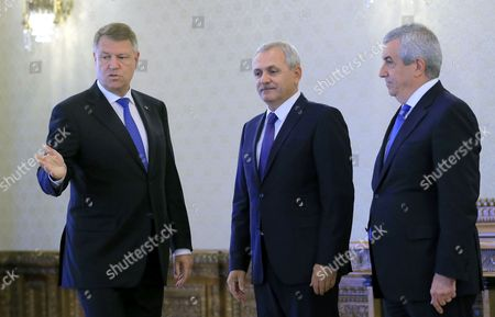 Liviu Dragnea (C), the president of the Romanian Parliament's Deputee Chamber, also the leader of the main ruling party PSD (Social Democracy Party) and Calin Popescu Tariceanu (R), the head of Senate Chamber, are  welcomed by Romania's President Klaus Iohannis (L) during the consultations held at Cotroceni Palace in order to establish the future Prime Minister, in Bucharest, Romania on 26 April 2017. Mihai Tudose, 50, former economy minister under Grindeanu cabinet, was proposed by the main ruling party PSD (Social Democracy Party) as their nomination for premier. Tudose must be designated as the new prime minister by the Romanian President and his cabinet must pass the parliament vote. The government directed by Sorin Grindeanu was ousted after a no-confidence vote was pushed by PSD in parliament last week. Dragnea and Tariceanu are the leaders of the ruling coalition that have the majority in parliament.