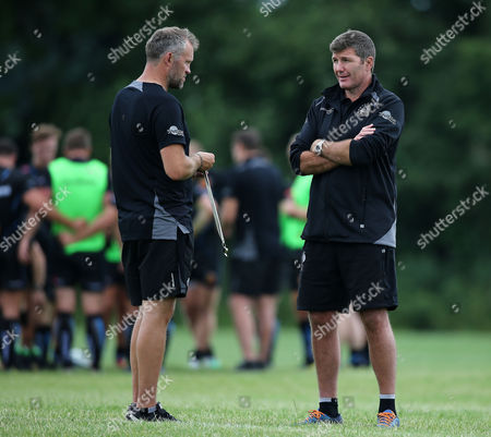 Exeter Chiefs Assistant Coach, Robin Hunter (L) talks with Exeter Chiefs Head Coach, Rob Baxter (R) during the Exeter Chiefs training session at Sandy Park Training ground on June 26th , Exeter, Devon.