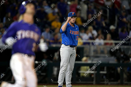 Florida pitcher Michael Byrne (17) reacts after defeating LSU 4-3 in Game 1 of the NCAA College World Series baseball finals in Omaha, Neb